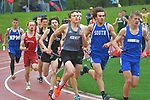 Male high school runners in the 3200 meter race.