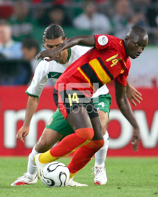 Mendonca (14) of Angola moves the ball away from Rafael Marquez (4) of Mexico. Mexico and Angola played to a 0-0 tie in their FIFA World Cup Group D match at FIFA World Cup Stadium, Hanover, Germany, June 16, 2006.