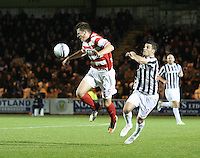 Michael Devlin beats Lewis Guy in the St Mirren v Hamilton Academical Scottish Communities League Cup match played at St Mirren Park, Paisley on 25.9.12.