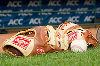 A couple of Rawlings baseball gloves sit on the field following the 2012 ACC Baseball Championship game between the Georgia Tech Yellow Jackets and the Miami Hurricanes at NewBridge Bank Park on May 27, 2012 in Winston-Salem, North Carolina.  The Yellow Jackets defeated the Hurricanes 8-5.  (Brian Westerholt/Four Seam Images)