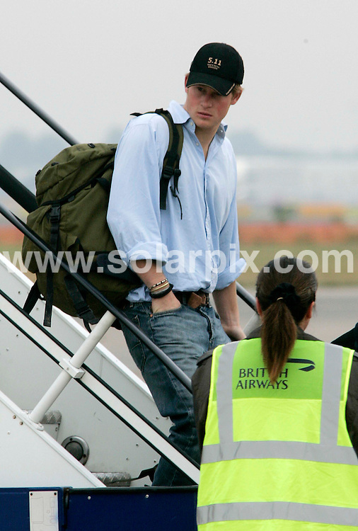 **ALL ROUND PICTURES FROM SOLARPIX.COM**.**NO UK NEWSPAPER PUBLICATION **UK MAGAZINE PUBLICATION ONLY** AND NO PUBLICATION IN FRANCE, SCANDINAVIA, AUSTRALIA AND GERMANY** .Prince Harry arrives home at Heathrow Airport with the England Rugby team after they lost against South Africa in the Rugby World Cup in Paris on saturday .This pic:HRH PRINCE HARRY.JOB REF:5129-SFE       DATE:20_10_07 .**MUST CREDIT SOLARPIX.COM OR DOUBLE FEE WILL BE CHARGED* *UNDER NO CIRCUMSTANCES IS THIS IMAGE TO BE REPRODUCED FOR ANY ONLINE EDITION WITHOUT PRIOR PERMISSION*