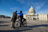 A United States Capitol Police Officer gives directions outside the United States Capitol Building on the morning of January 19th, 2018 as congress works to pass a spending bill by midnight. Failure to do so would shut down the United States Government. Credit: Alex Edelman / CNP