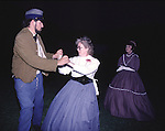 William Woods spins Jennifer Wallace, while dancing the Virginia Reel during a Civil War Ball held after the Battle of Fort Morgan, Mobile, Al in 2001. Jim Bryant Photo. @2001. All Rights Reserved.