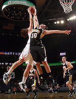 Dec. 18, 2010; Charlottesville, VA, USA; UMBC Retrievers 6-0 Meghan Colabella forward (10) defends Virginia Cavaliers forward Chelsea Shine (50) as she shoots the ball during the game at the John Paul Jones Arena. Virginia won 61-46. Mandatory Credit: Andrew Shurtleff-