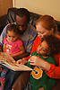 Family sitting reading a children's book