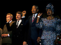 Montreal (Qc) CANADA, June 20, 1990 File Photo.<br />  Jean Dore (L) ; the Mayor of Montreal ,<br /> South African opposition leader Nelson Mandela (M),and his wife Winnie (R)  raise their fist to salute the crowd right after his speech in front the black community in Montreal (Quebec, Canada) on June 20, 1990,<br /> <br /> Photo (c) 1990, by Pierre Roussel - IMAGES DISTRIBUTION