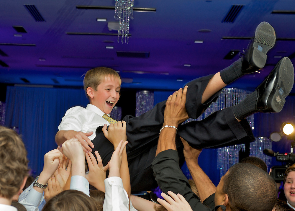 The hora- Bar Mitzvah boy being lifted.