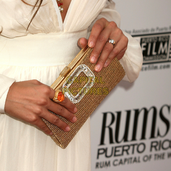 "JENNIFER LOPEZ.The Picturehouse L.A. Premiere of ""El Cantante"" held at The DGA in West Hollywood, California, USA..July 31st 2007.gold purse clutch bag sparkly silver hand detail close-up beaded ring orange .CAP/ADM/BP.©Byron Purvis/AdMedia/Capital Pictures"