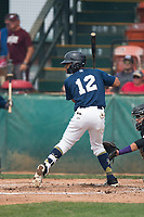 Helena Brewers center fielder Pablo Abreu (12) at bat during a Pioneer League game against the Grand Junction Rockies at Kindrick Legion Field on August 19, 2018 in Helena, Montana. The Grand Junction Rockies defeated the Helena Brewers by a score of 6-1. (Zachary Lucy/Four Seam Images)