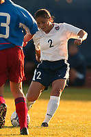 Lorrie Fair tries to get past Marina Burakova of Russia. The USWNT defeated Russia 5-1 on  September 29, at Mitchel Athletic Complex, Uniondale, NY.