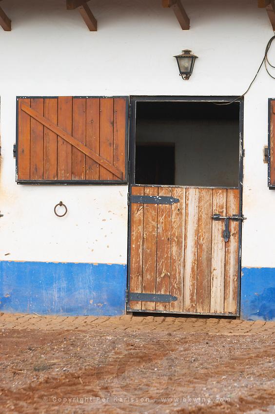 The stable door half open and closed. Herdade da Malhadinha Nova, Alentejo, Portugal