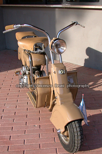 A 1948 Lambretta scooter (model 'A' 125 cc) standing on a bricks floor.