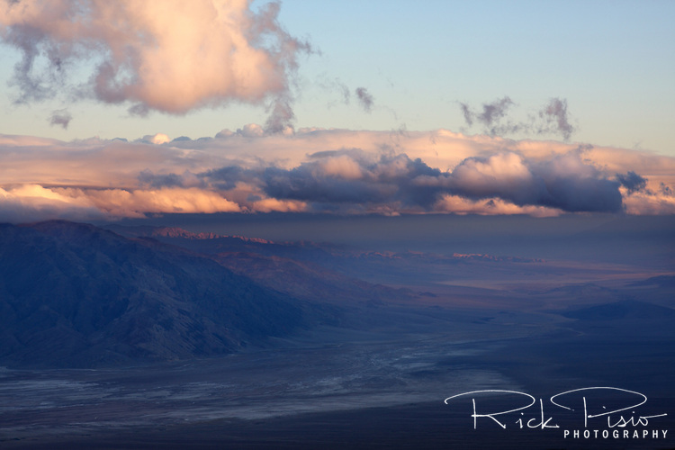The last of the day's light touches the peaks of the Amargosa Range in Death Valley National Park