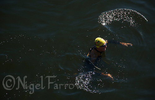 25 AUG 2013 - STOCKHOLM, SWE - A competitor warms up before his wave start of the Stockholm Triathlon in Stockholm, Sweden (PHOTO COPYRIGHT © 2013 NIGEL FARROW, ALL RIGHTS RESERVED)
