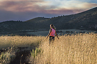 A woman appears in a field in Southern Utah at sunset