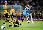 Borussia Dortmund midfielder Nuri Sahin (c) trips up with Manchester City striker Alex Zinchenko (r) during the match between Manchester City FC during their 2016 International Champions Cup China match at the Shenzhen Stadium on 28 July 2016 in Shenzhen, China. Photo by Marcio Machado / Power Sport Images
