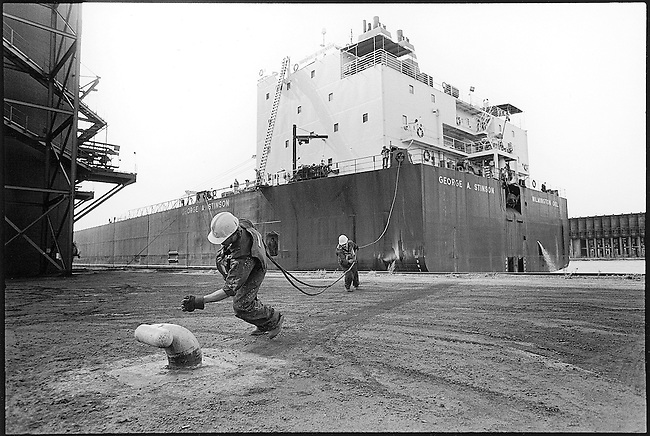 The crew of the George Stinson ties up the 1,000 foot freighter at the ore doscks in Superior, Wisconsin.