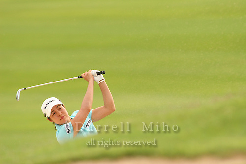 Feb 25, 2006; Kapolei, HI, USA;  Aree Song pitches on to the green during the final round at the inaugural LPGA Fields Open at Ko Olina Resort. ..Photo Credit: Darrell Miho .Copyright © 2006 Darrell Miho