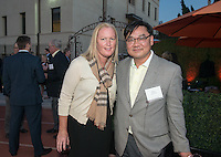 Director of Athletics Jaime Hoffman and Chris Lee P'18. Alumni, family, staff and students at the Occidental College Athletics Hall of Fame event, part of Homecoming weekend, Oct. 24, 2014 on Patterson Field. (Photo by Marc Campos, Occidental College Photographer)