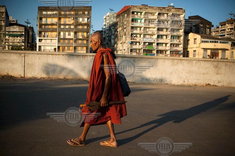 A monk walks near the docks in Yangon.