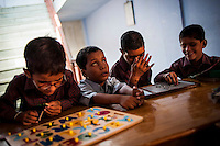 Visually and hearing impaired children attend an interactive learning session at the Sewa Ashram in Bikaner in the northern indian state of Rajasthan.