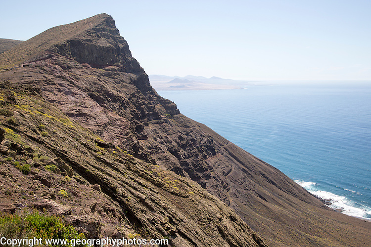 Steep coastal cliffs Risco de Famara looking south from Guinate, Lanzarote, Canary Islands, Spain