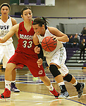 SIOUX FALLS, SD - JANUARY 16:  Taylor Varsho #3 from the University of Sioux Falls drives against Cheyenne Ironheart #33 from Minnesota Moorhead in the second half of their game Friday night at the Stewart Center.  (Photo by Dave Eggen/Inertia)