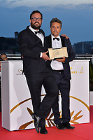 CANNES, FRANCE. May 25, 2019: Juliano Dornelles & Kleber Mendonca Filho at the Palme d'Or Awards photocall at the 72nd Festival de Cannes.<br /> Picture: Paul Smith / Featureflash