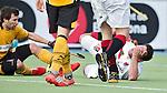 AMSTELVEEN - HOCKEY -  Valentin Verga van Amsterdamn raakt geblesseerd door een stick van de Spanjaard Sergi Enrique, die hem bij zijn blessure helpt,  tijdens de EHL K.O. hockeywedstrijd tussen  de mannen van Amsterdam en het Spaanse Atletic Terrassa . COPYRIGHT KOEN SUYK