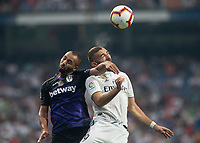 Karim Benzema of Real Madrid and El Zhar of Cd Leganes during the match between Real Madrid v Cd Leganes of LaLiga, 2018-2019 season, date 3. Santiago Bernabeu Stadium. Madrid, Spain - 1 September 2018. Mandatory credit: Ana Marcos / PRESSINPHOTO