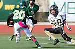 Manhattan Beach, CA 10/24/13 - Nick Orlando (Peninsula #27) and unidentified Mira Costa player(s) in action during the Palos Verdes Peninsula and Mira Costa Junior Varsity Football game at Mira Costa High School.