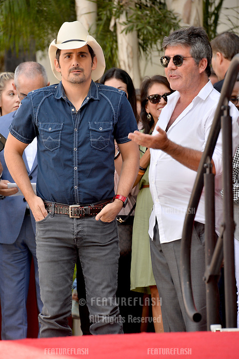 LOS ANGELES, CA. September 20, 2018: Brad Paisley & Simon Cowell at the Hollywood Walk of Fame Star Ceremony honoring singer Carrie Underwood.<br /> Pictures: Paul Smith/Featureflash