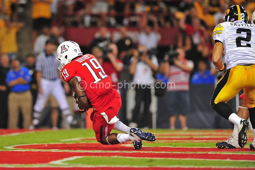 Sept 18, 2010; Tucson, AZ, USA; Arizona Wildcats wide receiver William Wright (19) catches touchdown pass in the 4th quarter of a game against the Iowa Hawkeyes at Arizona Stadium. Arizona won the game 34-27.