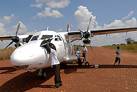UGANDA Kitgum, small aircraft of Eagle air at airstrip Kitgum  / UGANDA Kitgum, kleines Flugzeug der Eagle Air auf Sandpiste des Flughafens