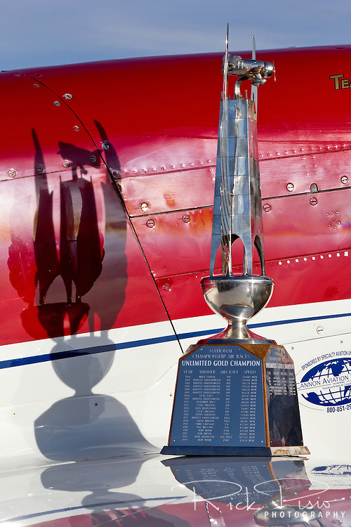"Unlimited Gold Championship trophy sits on the wing of 2012 Unlimited Champion ""Strega."""