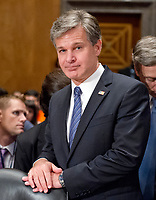 "Christopher A. Wray, Director, Federal Bureau of Investigation (FBI) waits to testify before the United States Senate Committee Homeland Security and Governmental Affairs on ""Threats to the Homeland"" on Capitol Hill in Washington, DC on Wednesday, September 27, 2017. Photo Credit: Ron Sachs/CNP/AdMedia"