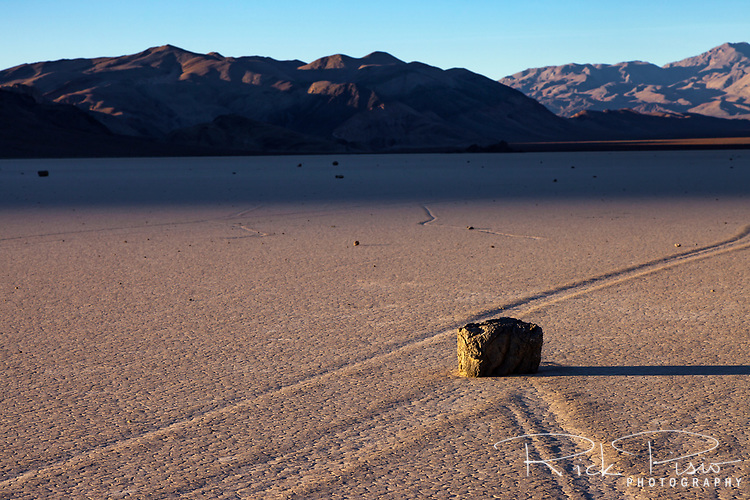 The trail left by a sailing rock on the Racetrack Playa in Death Valley National Park is evidence of the rocks motion across the playa. The Racetrack Playa is known for its 'sailing stones' which are rocks that mysteriously move across its surface.