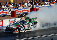 Apr 7, 2006; Las Vegas, NV, USA; NHRA Funny Car driver Eric Medlen does a burnout in Castrol Syntec Ford Mustang during qualifying for the Summitracing.com Nationals at Las Vegas Motor Speedway in Las Vegas, NV. Mandatory Credit: Mark J. Rebilas