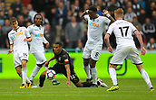 10th September 2017, Liberty Stadium, Swansea, Wales; EPL Premier League football, Swansea versus Newcastle United; Isaac Hayden (C) of Newcastle United and Leroy Fer of Swansea City battle for possession during the match