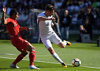 New Zealand's Declan Wynne passes under pressure from Peru's Edison Flores (left) during the 2018 FIFA World Cup Russia first-leg playoff football match between the NZ All Whites and Peru at Westpac Stadium in Wellington, New Zealand on Saturday, 11 November 2017. Photo: Dave Lintott / lintottphoto.co.nz