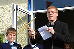 Fr. Rory Coyle uses a traditional St. Brigid's Cross to bless the new school extension at Scoil Bhride Dunleer. Photo:  Andy Spearman.