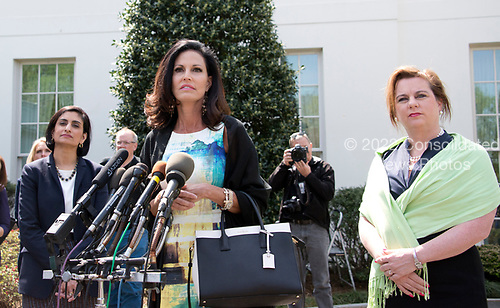 From left to right: Centers for Medicare and Medicaid Services (CMS) Administrator Seema Verma, Penny Nance, CEO of Concerned Women for America and Marjorie Dannenfelser, president of the Susan B.Anthony List appear for brief statements at the White House after United States President Donald J. Trump signed House Joint Resolution 43 (H.J. Res. 43), which allows states to withhold federal funds from facilities that provide abortion services, in Washington, DC on April 13, 2017.<br /> Credit: Ron Sachs / CNP