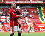 Wayne Rooney of Manchester United takes a walk around the ground with his youngest son Kit during the English Premier League match at the Old Trafford Stadium, Manchester. Picture date: May 21st 2017. Pic credit should read: Simon Bellis/Sportimage