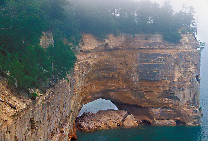 The Grand Portal rock formationin the fog at Pictured Rocks National Lakeshore near Munising, Mich.