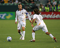 LA Galaxy midfielder David Beckham (23) and forward Cobi Jones (13) chase down a ball. CD Chivas USA defeated the LA Galaxy 3-0 in the Super Classico MLS match at the Home Depot Center in Carson, California, Thursday, August 23, 2007.
