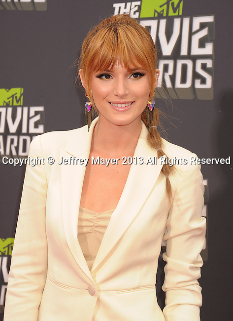 CULVER CITY, CA- APRIL 14:  Actress Bella Thorne arrives at the 2013 MTV Movie Awards at Sony Pictures Studios on April 14, 2013 in Culver City, California.