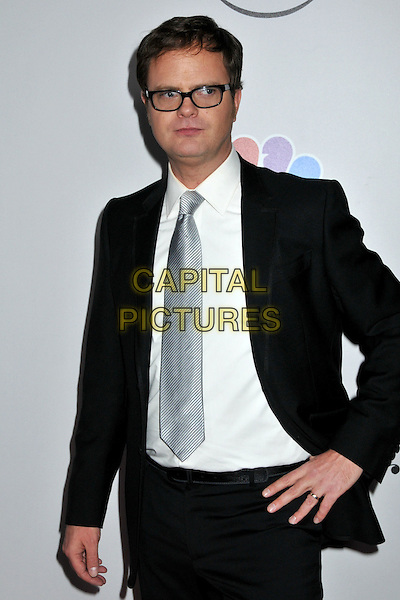 RAINN WILSON.NBC Universal 66th Annual Golden Globes Post Party at the Beverly Hilton Hotel, Beverly Hills, California, USA..January 11th, 2009.half length black suit jacket hand on hip white blue shirt tie glasses .CAP/ADM/BP.©Byron Purvis/AdMedia/Capital Pictures.