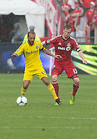 July 27, 2013: Columbus Crew forward Federico Higuain #33 battles with Toronto FC defender Steven Caldwell #13 during an MLS regular season game between the Columbus Crew and Toronto FC at BMO Field in Toronto, Ontario Canada.<br /> Toronto FC won 2-1.