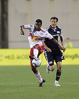New York Red Bulls midfielder Danleigh Borman (11) attempts to trap the ball as New England Revolution midfielder Marko Perovic (29) closes. The New England Revolution defeated the New York Red Bulls, 3-2, at Gillette Stadium on May 29, 2010.