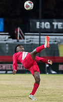 COLLEGE PARK, MD - NOVEMBER 15: Herbert Endeley #17 of Indiana boots the ball upfiled during a game between Indiana University and University of Maryland at Ludwig Field on November 15, 2019 in College Park, Maryland.